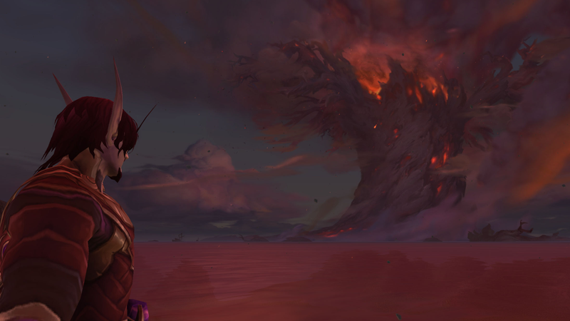 My current World of Warcraft character, a scuzzy-looking Void Elf Mage, looks out at the burning remnants of the World Tree, Teldrassil.