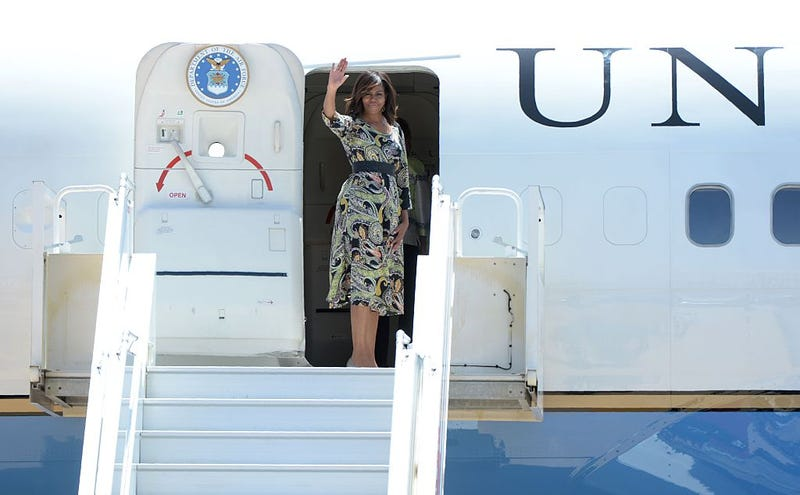 First lady Michelle Obama waves as she boards her plane prior to departure from the Moroccan city of Marrakesh on June 29, 2016. FADEL SENNA/AFP/Getty Images