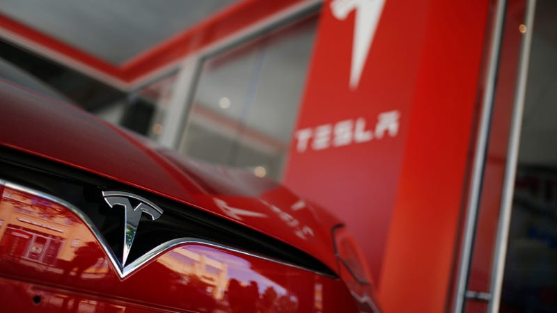 Tesla says it is investigating cause of fatal China crash