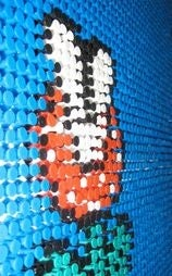 Illustration for article titled Gamer Turns 17K Push Pins Into Mosaic Art