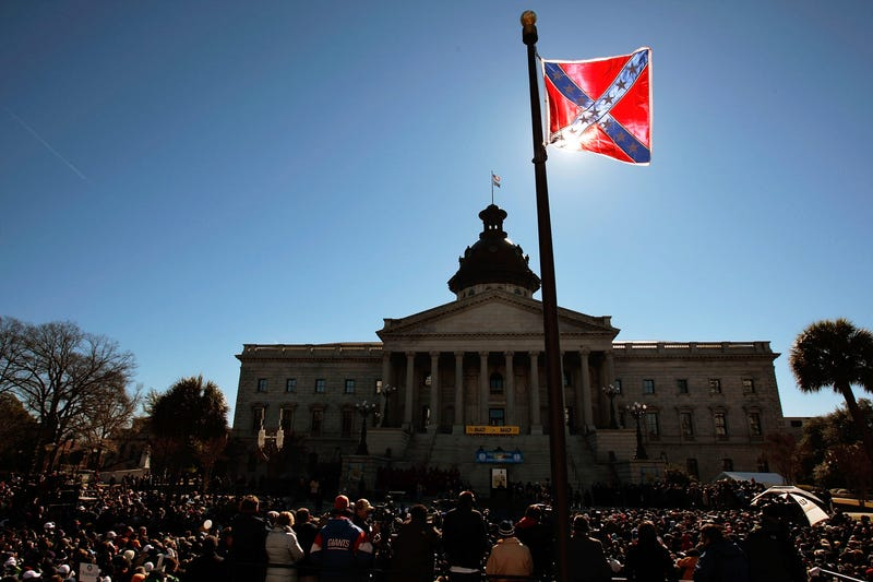A Confederate flag that's part of a Civil War memorial on the grounds of the South Carolina Statehouse flies over a Martin Luther King Day rally Jan. 21, 2008, in Columbia. (Chris Hondros/Getty Images)