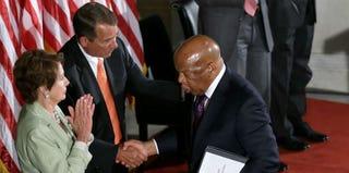 Nancy Pelosi and John Boehner greet John Lewis. (Getty Images)