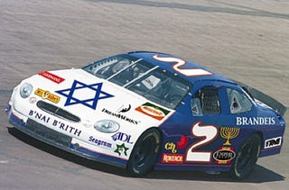 Illustration for article titled Full-Lox Slide Dept: Jew-Sponsored Stock Car Booed Off Track