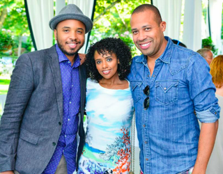 Director Justin Simien with two guests at The Root 100 Release List Reception on Martha's Vineyard, Mass., Aug. 19, 2014Getty Images for The Root