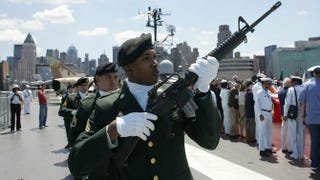 A military squad prepares to fire a salute aboard the USS Intrepid during a Memorial Day service May 30, 2005, in New York City.David Turnley/Getty Images