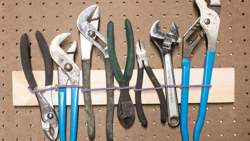 Illustration for article titled This DIY Elastic Tool Holder Keeps Everything You Need Close at Hand