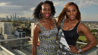 Venus and Serena Williams pose for a portrait on a hotel rooftop in Melbourne, Australia, during a media event for the Australian Open tennis tournament Jan. 9, 2014.PAUL CROCK/AFP/Getty Images