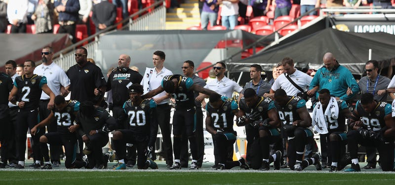 Jacksonville Jaguar players protest during the national anthem at the NFL International Series match between the Baltimore Ravens and the Jaguars at Wembley Stadium on Sept. 24, 2017, in London.