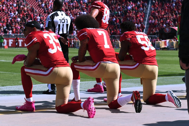Eric Reid, Colin Kaepernick and Eli Harold  of the San Francisco 49ers kneel in protest during the national anthem prior to their NFL game Oct. 23, 2016, in Santa Clara, Calif. In 2017, a high school in Louisiana is threatening to kick student-athletes off its sports teams if they decide to take a knee during the playing of the national anthem at games. (Thearon W. Henderson/Getty Images)