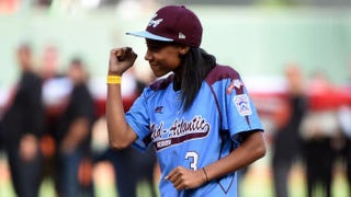 Little League Baseball pitcher Mo'ne Davis reacts after she throws out the ceremonial first pitch before Game 4 of the 2014 World Series at AT&T Park Oct. 25, 2014, in San Francisco.Kyle Terada-Pool/Getty Images