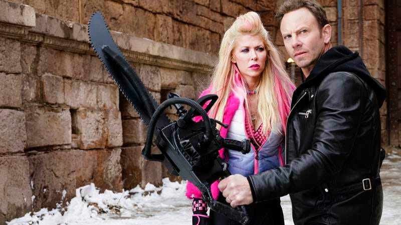 Tara Reid, Ian Ziering, the invisible ghosts of a thousand sharks wailing for justice (Image: SyFy)