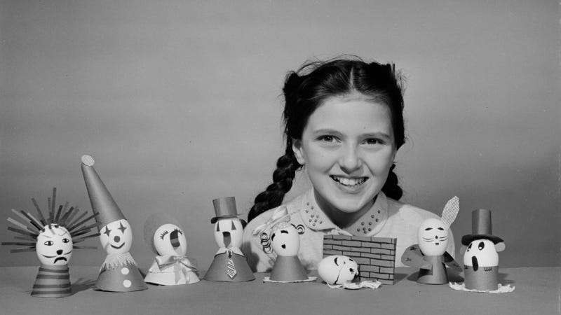 A young girl with some eggs she has decorated for Easter, circa 1955. Images via Getty.