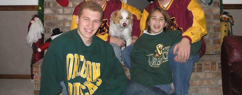 From left to right: Bob, our dog Woody, and me, sitting in front.