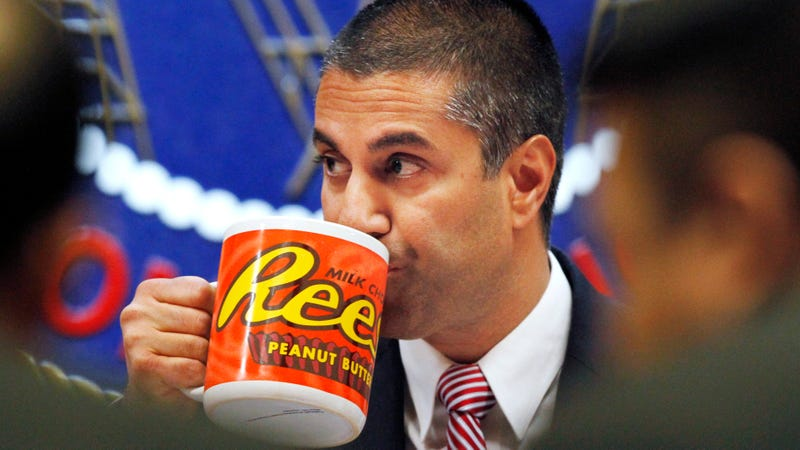 Federal Communications Commission (FCC) Chairman Ajit Pai takes a drink from a mug during an FCC meeting where the FCC will vote on net neutrality, Thursday, Dec. 14, 2017, in Washington.