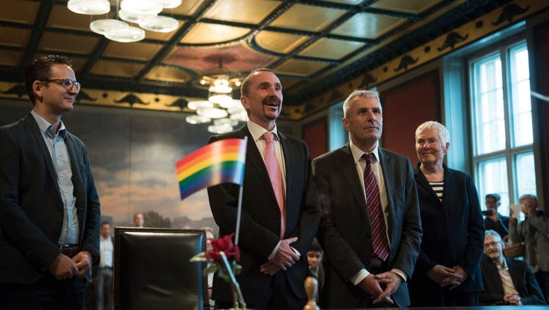 Karl Kreile (2nd left) and Bodo Mende (3rd left) are the first gay couple to legally marry in Germany / Image via Getty