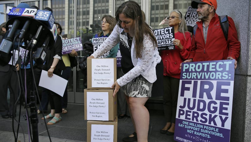 An activist from the advocacy group UltraViolet stacks boxes containing one million signatures to the California Commission on Judicial Performance calling for the removal of Judge Aaron Persky from the bench during a rally Friday, June 10, 2016, in San Francisco. Photo via AP.