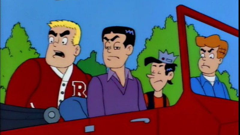 The old, old Reggie (center), on The Simpsons.