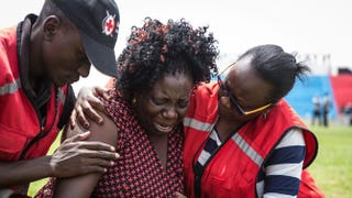 Members of the Red Cross help a woman overcome with grief in the Kenyan capital, Nairobi, April 5, 2015, after learning that a relative was killed by Somalia's al-Shabab militants during the siege at Garissa University College.NICHOLE SOBECKI/Getty Images