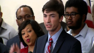 Levi Pettit, surrounded by black leaders and clergy March 25, 2015, in an Oklahoma City church, apologized for his role in the racist sing-along by members of the University of Oklahoma's Sigma Alpha Epsilon chapter that was captured on video and went viral shortly after being released.HLN screenshot
