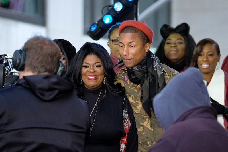 Kim Burrell and Pharrell Williams pose onstage during the Citi Concert Series on the Today show at Rockefeller Center in New York Dec. 9, 2016.  D Dipasupil/Getty Images for CITI
