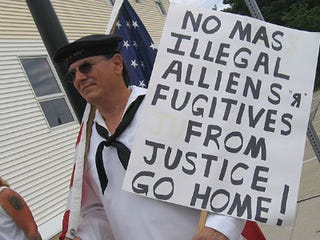 A man protests against illegal immigration. (Minnesota Public Radio)