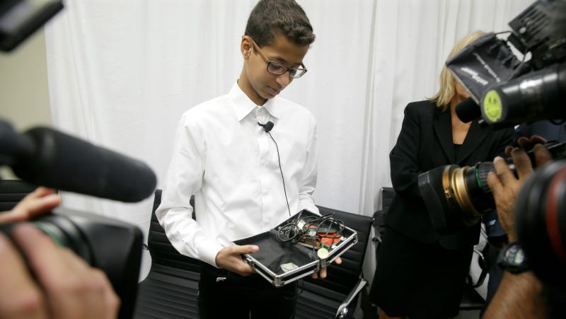 Mohamed shows off his clock after a press conference, Monday August 8, 2016. Photo via AP.