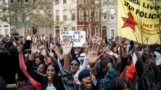 Protesters rally after a march for Freddie Gray that ended in front of the Baltimore Police Department's Western District police station April 21, 2015, in Baltimore. Gray, 25, died from spinal injuries April 19, one week after being taken into police custody.Drew Angerer/Getty Images
