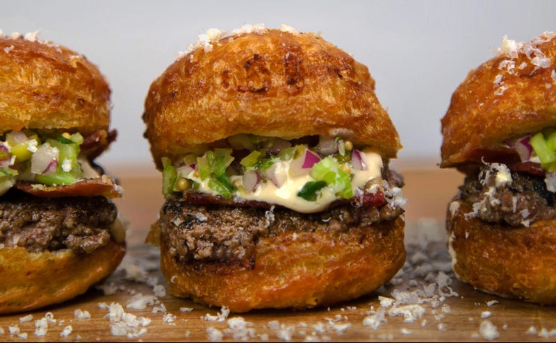 Illustration for article titled This parmesan cronut burger is the only thing in my mind right now