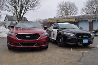 Illustration for article titled Ford Taurus SHO vs. Ford Taurus Police Interceptor Sedan