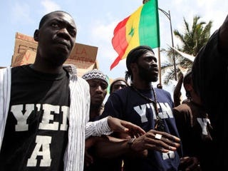 Senegalese rappers march during a rally. (Rebecca Blackwell/Associated Press)