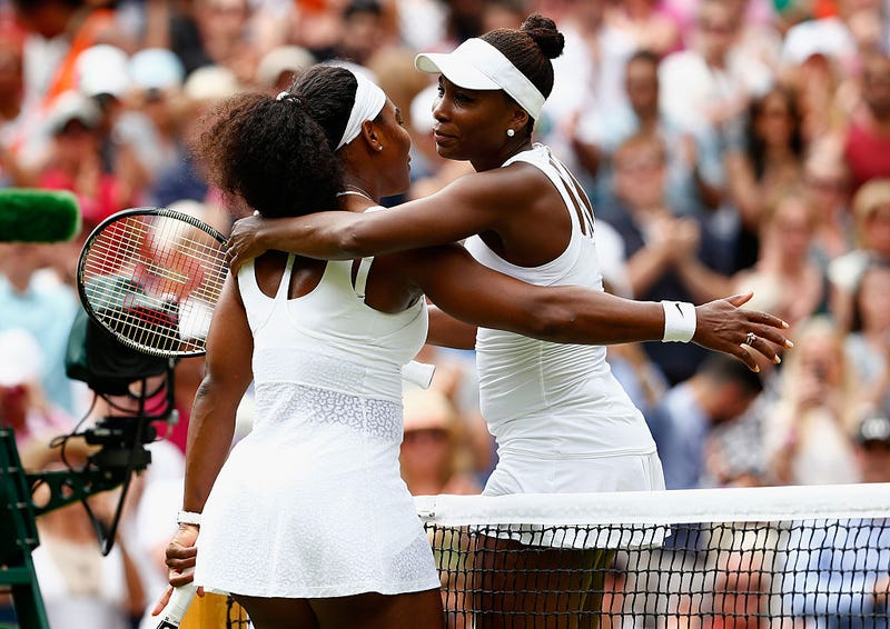 Serena Williams hugs sister Venus Williams after their ladies' singles fourth-round match at the Wimbledon Lawn Tennis Championships on  July 6, 2015, in London.Julian Finney/Getty Images