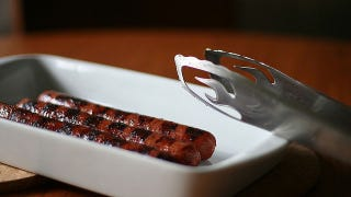 Illustration for article titled Poach or Roast Sausages Before Grilling (and Other Expert BBQ Tips)