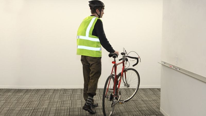 Illustration for article titled Coworker With Fluorescent Bike Vest Treats Office To Futuristic Light Show On Way To Desk