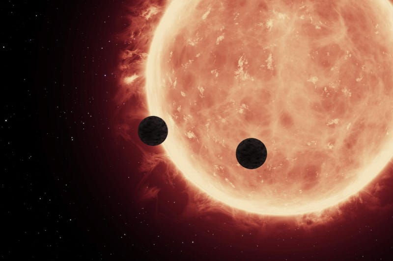 Artist's conception of the two planets transiting their sun (Image: NASA, ESA, AND STSCI)