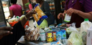 Clients stock up on supplies at a food pantry in New York City. (Spencer Platt/Getty Images)