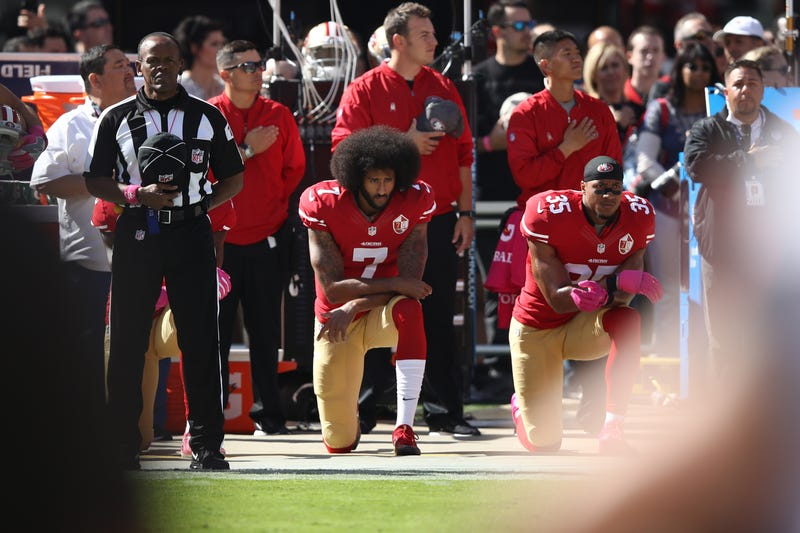 Colin Kaepernick, No. 7, then of the San Francisco 49ers, and teammate Eric Reid, No. 35, kneel in protest during the national anthem prior to their NFL game against the Tampa Bay Buccaneers at Levi's Stadium in Santa Clara, Calif., on Oct. 23, 2016. (Ezra Shaw/Getty Images)