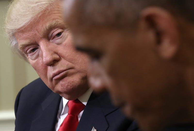 Donald Trump contemplates Barack Obama.