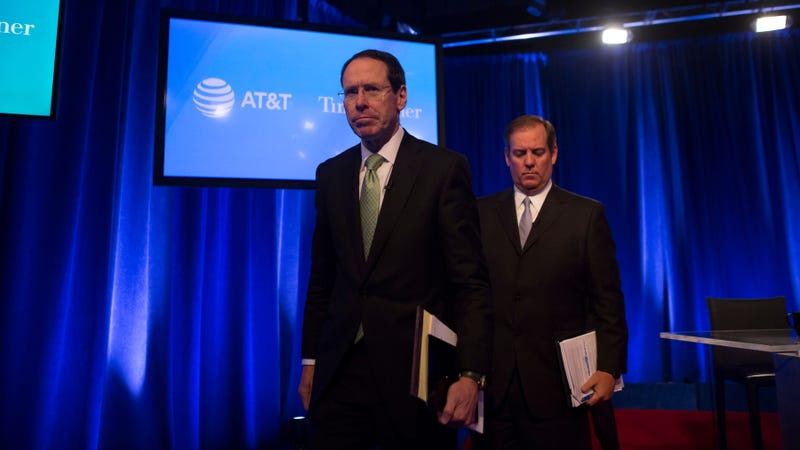 AT&T executives exit a news conference. (Photo: Getty)