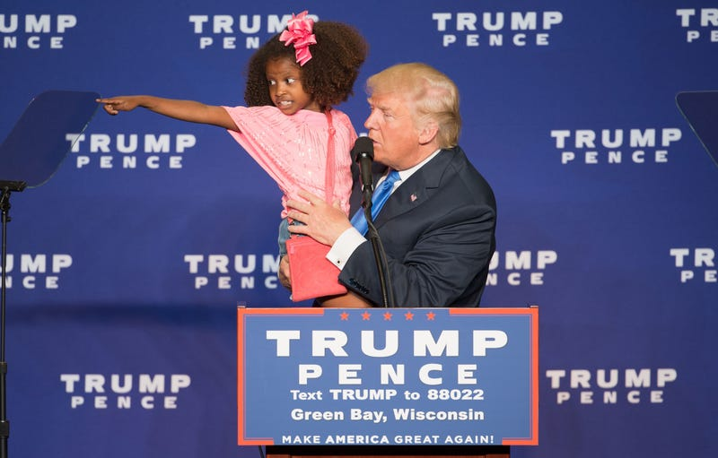 Republican presidential nominee Donald Trump holds a child as he speaks during a rally at the KI Convention Center in Green Bay, Wis., on Oct. 17, 2016.TASOS KATOPODIS/AFP/Getty Images