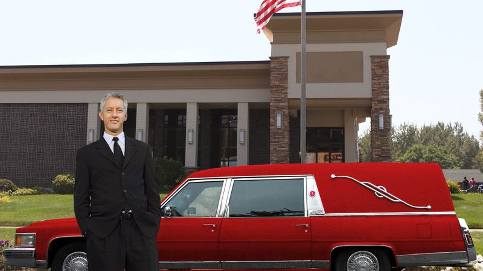 Middle-Aged Funeral Director Buys Flashy Red Hearse