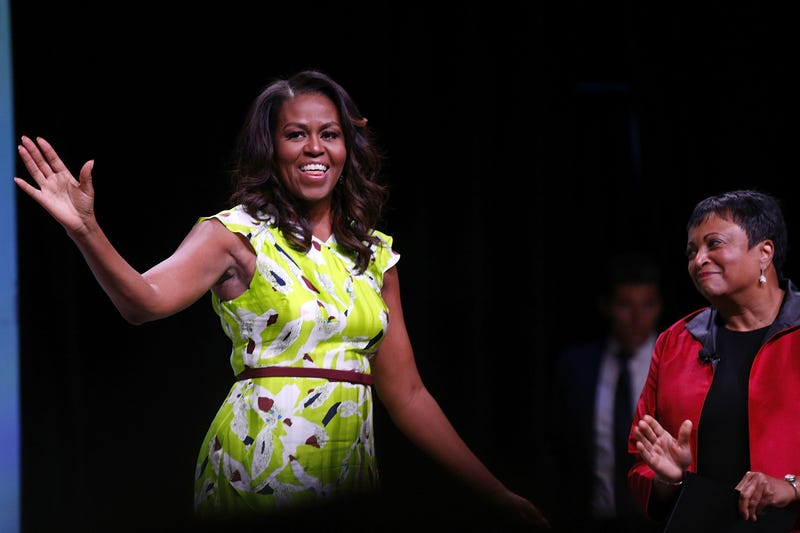 Former U.S. first lady Michelle Obama waves after discussing her forthcoming memoir during the 2018 American Library Association Annual Conference on June 22, 2018 in New Orleans, Louisiana