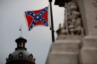 The Confederate flag flies on the Statehouse grounds in Columbia, S.C., June 23, 2015, one day after South Carolina Gov. Nikki Haley announced that she will call for the flag to be removed.Win McNamee/Getty Images