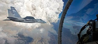 Illustration for article titled These Photos Of F-15s Flying Near Towering Forest Fires Are Totally Nuts