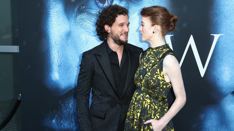 Kit Harington and Rose Leslie aka Jon Snow and Ygritte the Wildling REPRESENTING THEIR IRL LOVE. Images via Getty.