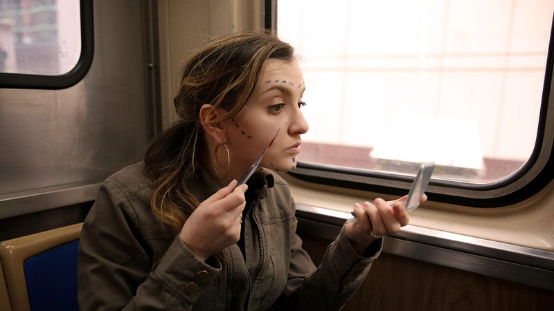 Illustration for article titled Harried Woman On Train Quickly Doing Plastic Surgery On Face Before Work