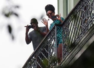 Beyoncé is seen on a balcony of the Saratoga Hotel in Havana next to her husband, Jay Z, on April 5, 2013.STR/AFP/Getty Images
