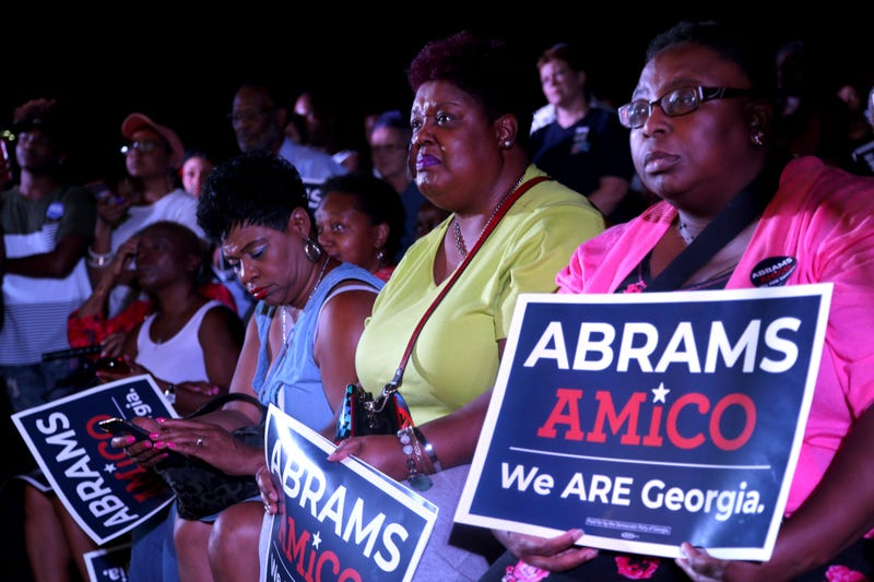 People looking on as Stacey Abrams speaks at a campaign stop at Savannah State University on Tuesday, October 16, 2018,