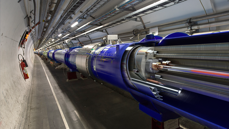 A diagram of the LHC superimposed on a photo of its beamline