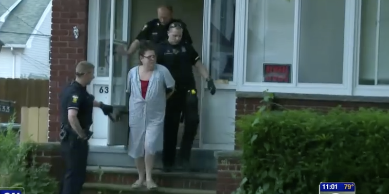 Patricia Edelen being taken into custody by police