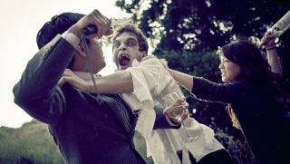 Illustration for article titled Zombie Invades Couple's Wedding Photos